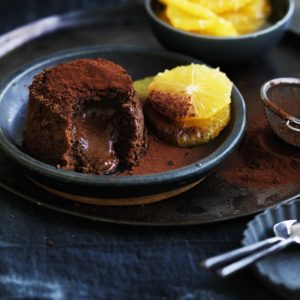Neil Perry's Good Weekend recipe: Chocolate fondant cake with grand marnier poached oranges.