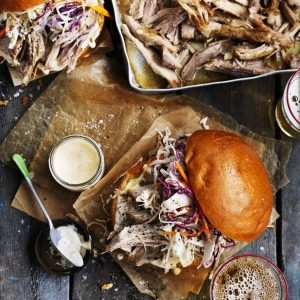 Neil Perry's Good Weekend recipe: Pulled pork & coleslaw burgers with chipotle mayo.