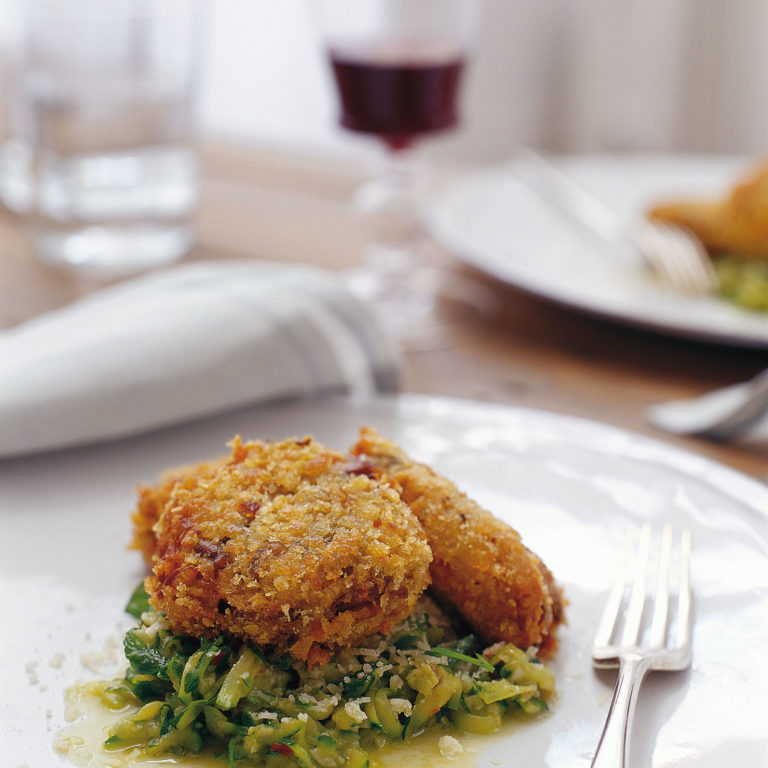 Mushroom risotto cakes with zucchini sauce