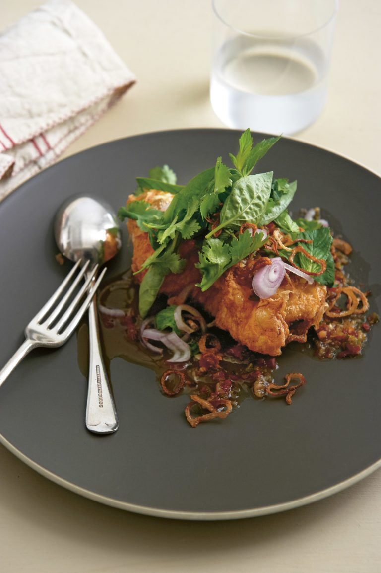Fried eggs with spicy tamarind dressing