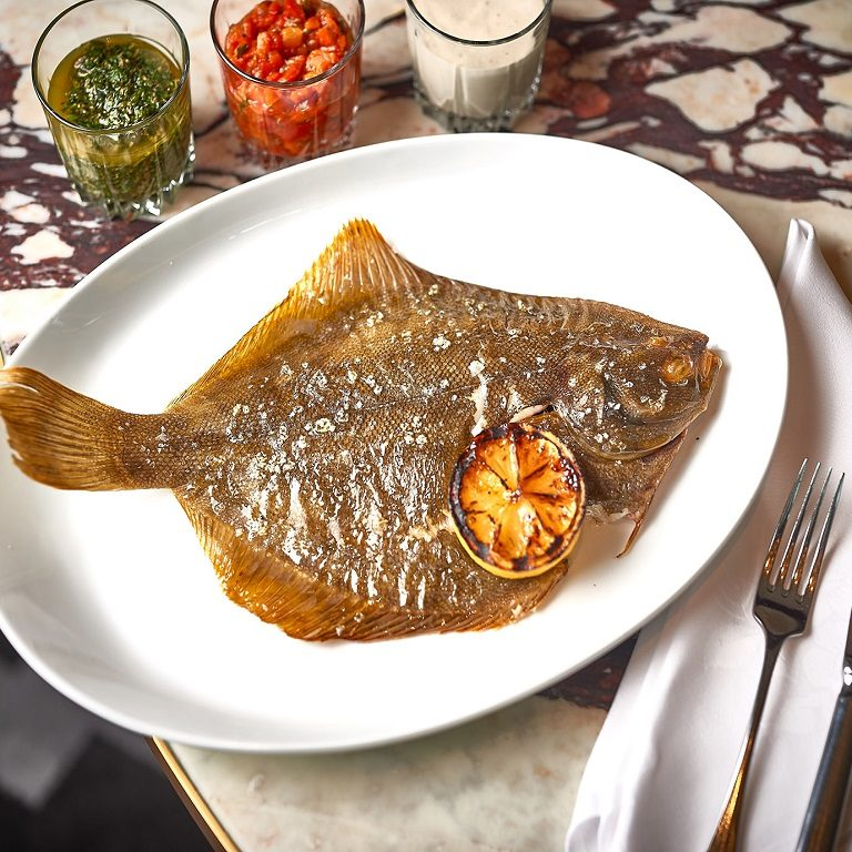 Whole flounder with herbs and garlic