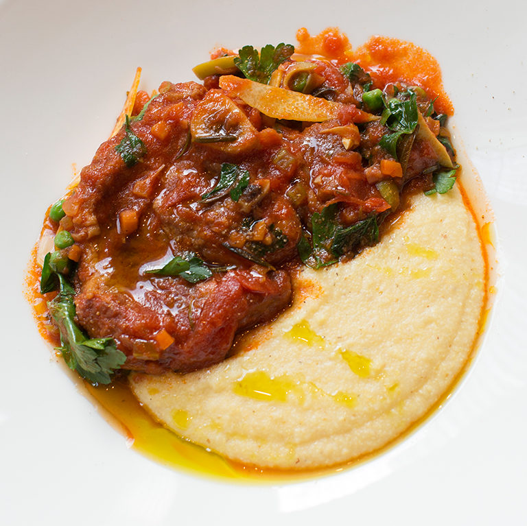 Braised veal osso bucco with peas and polenta
