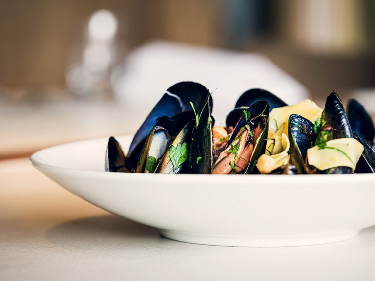 Steamed mussels with Joselito Jamón Ibérico, chilli, tomato & chickpeas